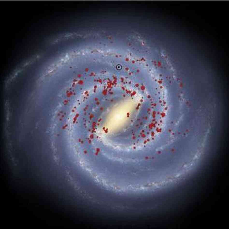An image showing the distribution of massive stars in the new study. Our location within the Galaxy is circled in black.