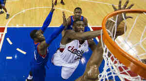 Wesley Matthews of the Portland Trail Blazers goes up for the shot as Philadelphia 76ers defend the basket on Saturday in Philadelphia.