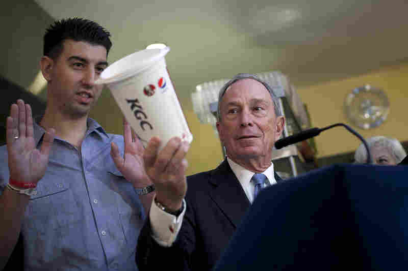Bloomberg holds a large cup as he speaks to the media about the effects of sugar on health at Lucky's restaurant, which voluntarily adopted a ban on large sugary drinks, March 12 in New York City. A state judge blocked Bloomberg's ban.