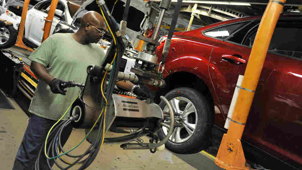 An auto worker tightens bolts on a Focus at a Ford plant in Michigan in October. Labor unions predicted in 1993 that NAFTA would send many U.S. manufacturing jobs to Mexico, and they continue to argue that the pact prompted a race to the bottom for workers.