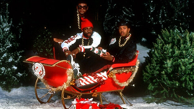Run-DMC, in a sleigh with a Cadillac emblem.