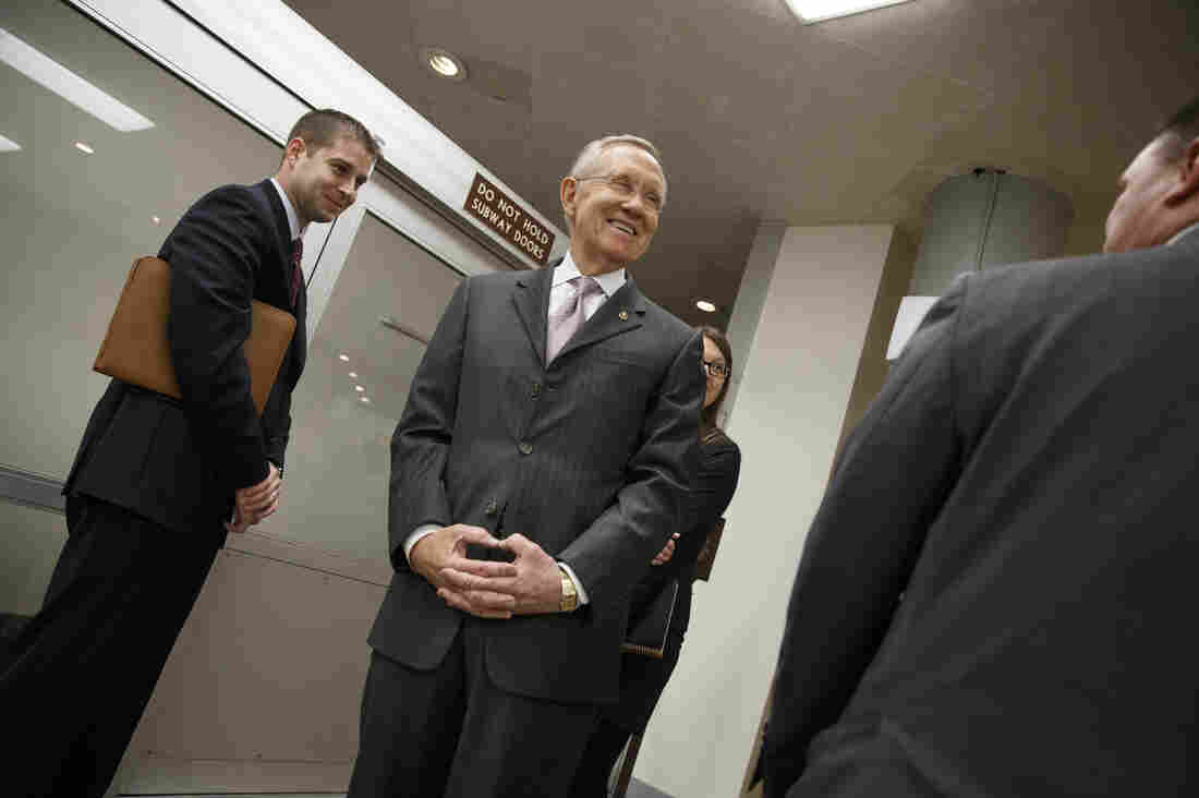 Majority Leader Harry Reid, D-Nev., takes a break from the Senate floor Tuesday after a bipartisan budget compromise cleared a procedural hurdle.