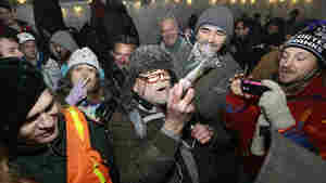 Partiers celebrate marijuana legalization in Washington state at a pot party in Seattle earlier this month.