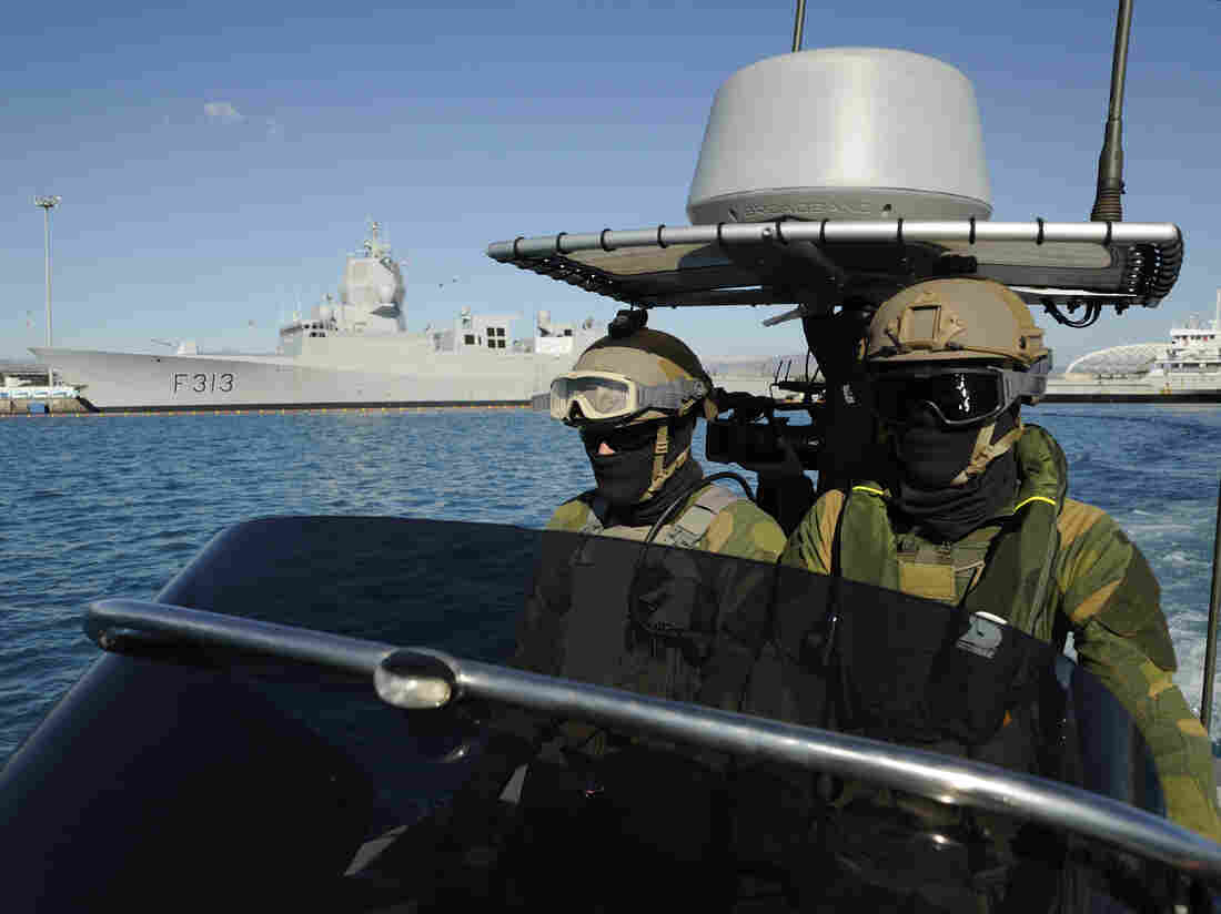 Norwegian marines patrol the waters around the Norwegian frigate HNOMS Helge Ingstad, which was docked in Cyprus over the weekend. The