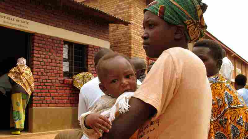 A mother waits with her child at an HIV clinic in Nyagasambu, Rwanda, in February 2008. The clinic was built with a grant from the President's Emergency Plan for AIDS Relief initiative.