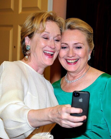 Actress Meryl Streep takes a photo of herself with then-Secretary of State Hillary Clinton in Washington last December.