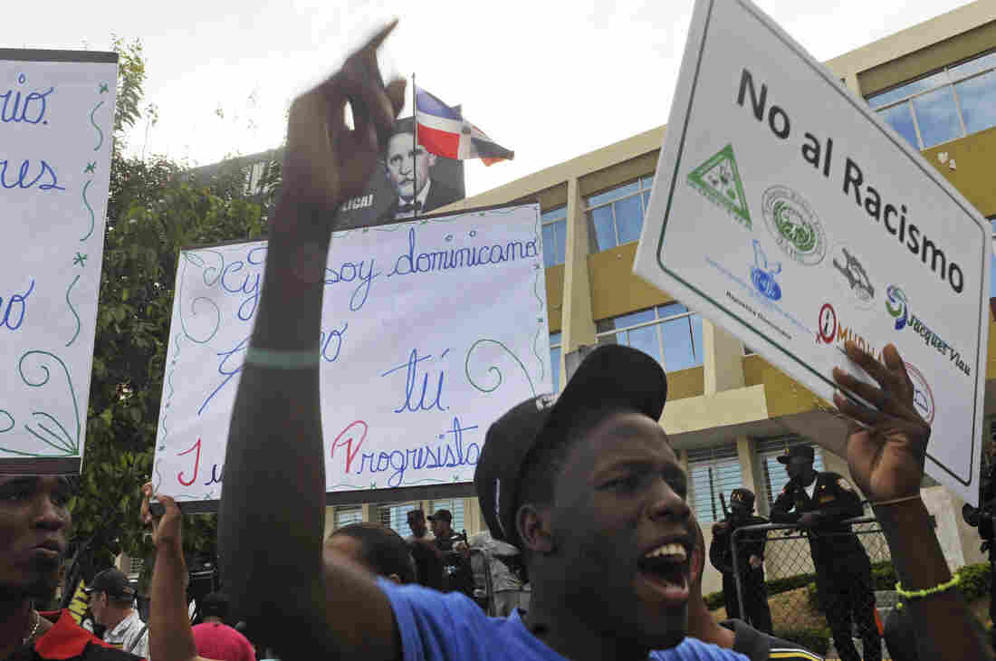 Dominicans of Haitian descent protest outside the Constitutional Court in Santo Domingo, Dominican Republic, on Oct 3.