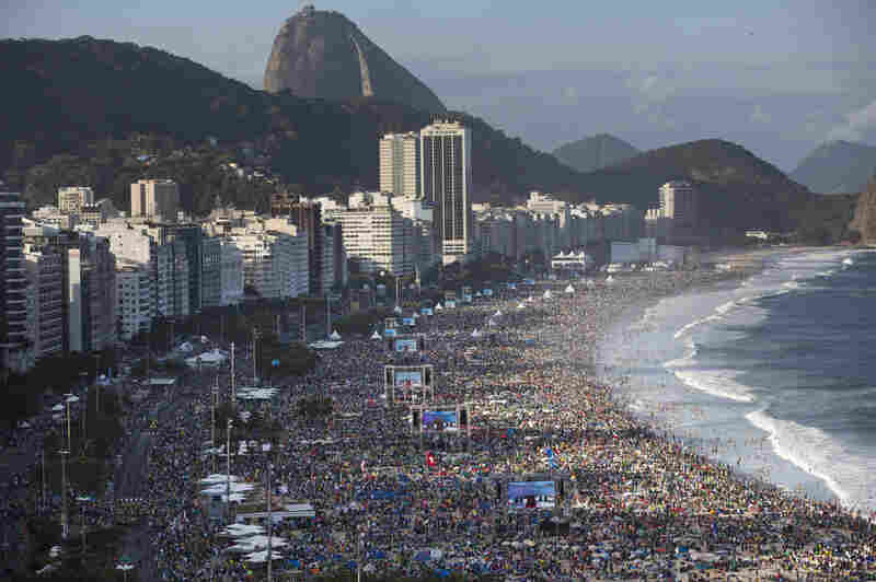 Pilgrims and residents gather on Copacabana beach before the arrival of Pope Francis for World Youth Day in Rio de Janeiro in July.