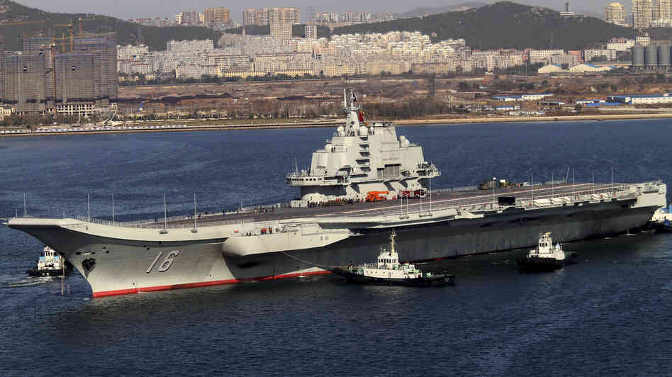 Chinese state media has said the incident involved its newly deployed aircraft carrier, Liaoning, shown here in October 20