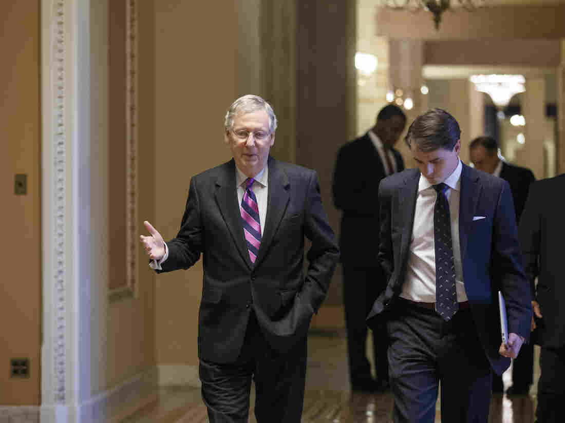 Senate Minority Leader Mitch McConnell (R-Ky.), walks to the chamber for the final votes on the bipartisan budget deal on Wednesday.