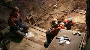 Research excavations like these in Siberia's Denisova Cave are yielding clues to the mating choices of early hominids.