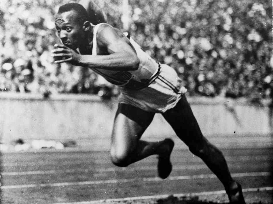 Jesse Owens runs in a 200-meter preliminary heat at the 1936 Summer Olympic Games in Berlin.