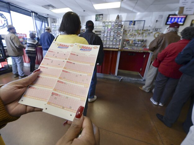 Holding a dream: Customers lined up Tuesday at a shop in Tallapoosa, Ga., to buy Mega Millions tickets.