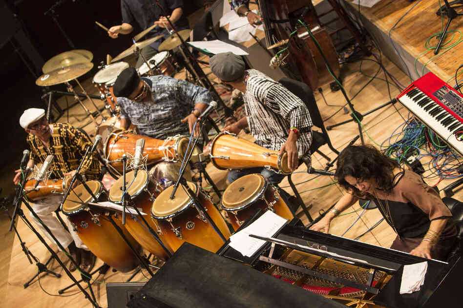 Michele Rosewoman (bottom right) is joined by batá percussionists in performance with her New Yor-Uba Ensemble