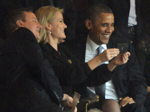 """President Obama and British Prime Minister David Cameron pose for a """"selfie"""" with Danish Prime Minister Helle Thorning Schmidt during the memorial service for Nelson Mandela."""