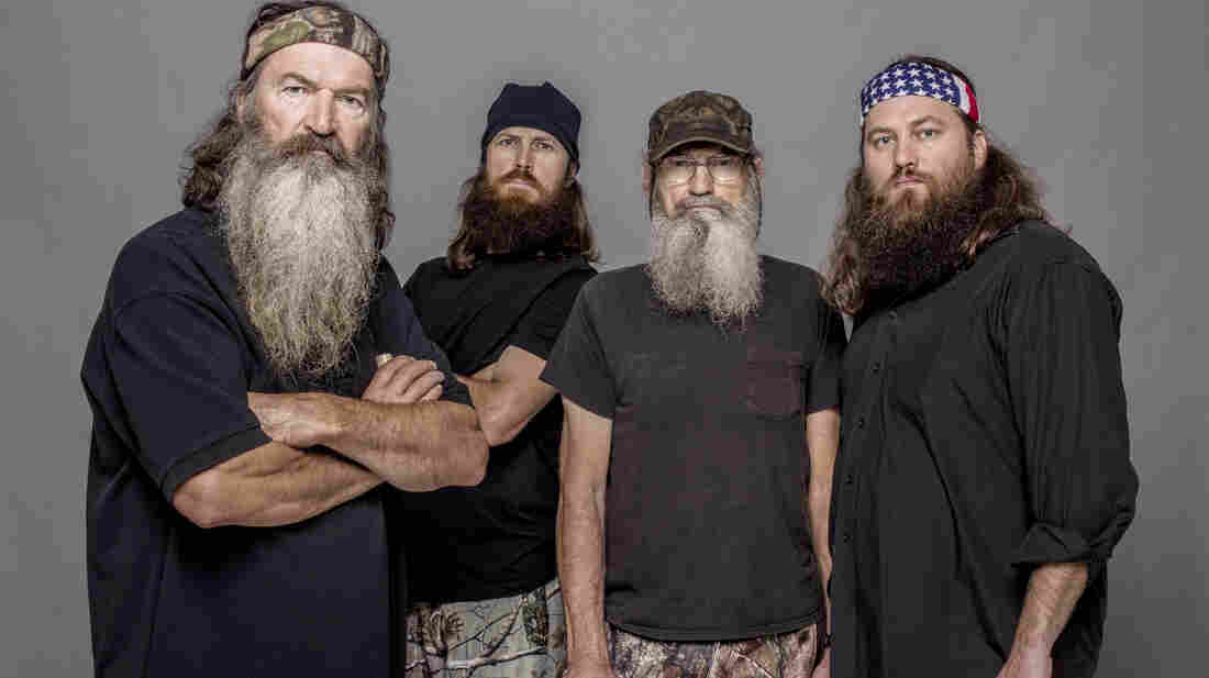 This 2012 photo released by A&E shows Phil Robertson (from left), Jase Robertson, Si Robertson and Willie Robertson from the A&E series Duck Dynasty.