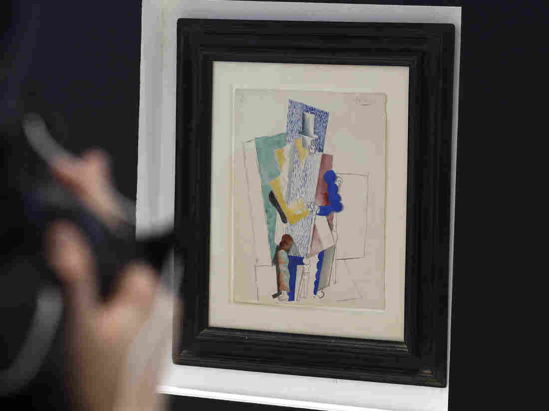 Picasso's 1914 cubist drawing L'homme au Gibus, or Man in the Opera Hat, is presented at Sotheby's auction house in Paris.
