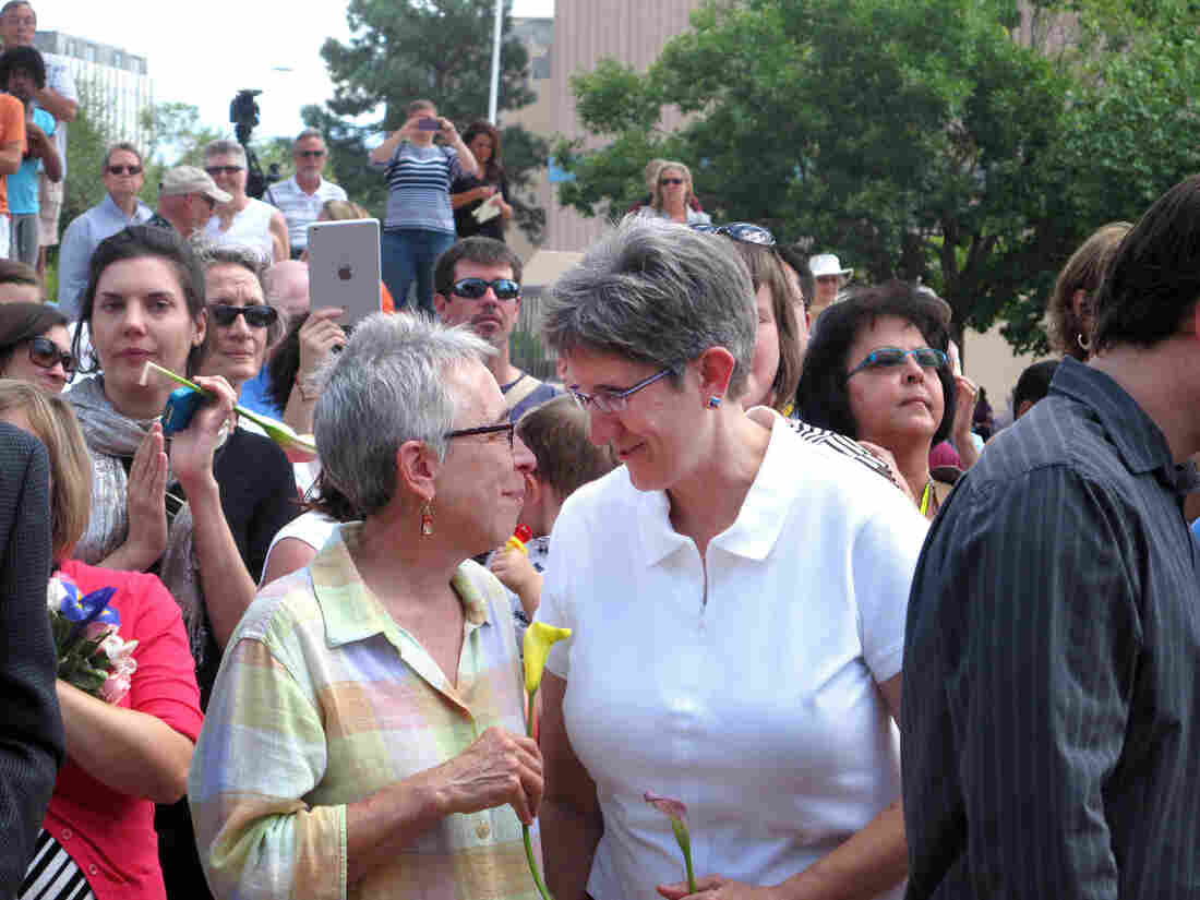 Gail Stockman, 60 (left), and Beth Black, 58, of Albuquerque, N.M., prepare to marry at a massive wedding in August, along with other same-sex couples.