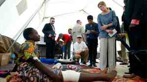 U.S. Ambassador to the Unitied Nations Samantha Power (right) listens to Lucy Mandazuto at a community hospital in Bangui, Central African Republic, on Thursday. Mandazuto was wounded in sectarian violence.