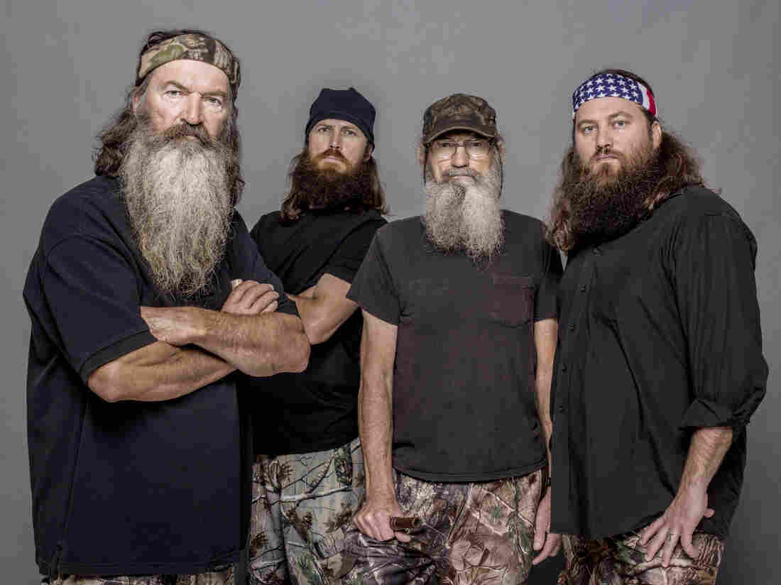 Four of the stars of Duck Dynasty, from left to right: Phil Robertson, Jase Robertson (Phil's son), Si Robertson (Phil's brother) and Willie Robertson (Phil's son).