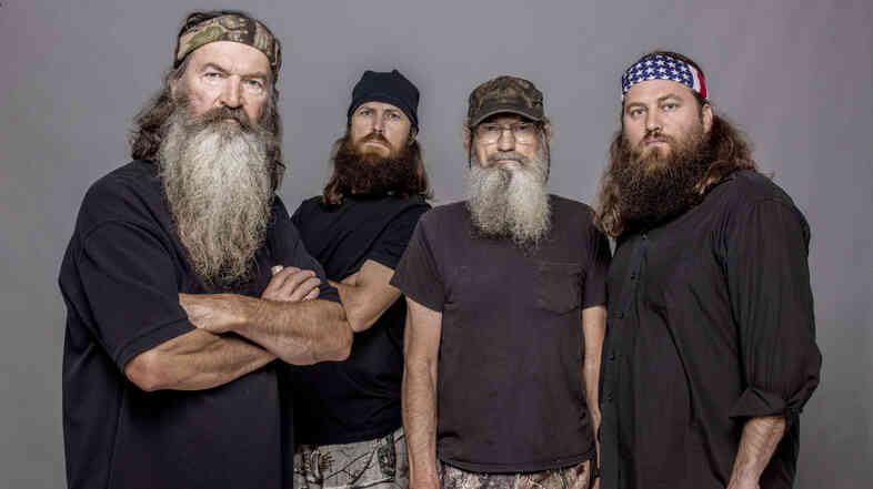 Four of the stars of Duck Dynasty, from left to right: Phil Robertson, Jase Robertson (Phil's son), Si Robertson (Phil'