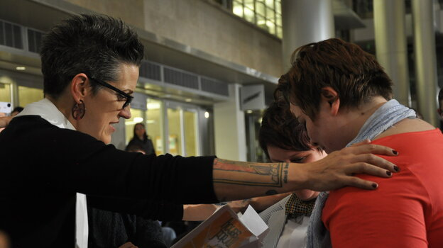 Pastor Nadia Bolz-Weber, shown here officiating civil union ceremonies in Denver in May, wrote a book on faith that recently landed on the New York Times best-s