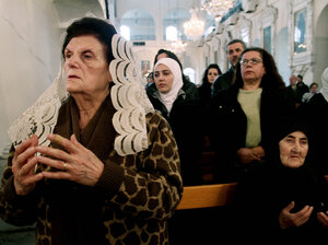Syrian Christians and Muslims at the Greek Orthodox Mariamiya Church in Damascus offer prayers for Greek Orthodox nuns who left their convent in Maaloula with rebels amid heavy fighting.