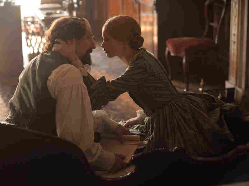 Ralph Fiennes as Charles Dickens, and Felicity Jones as Nelly Ternan