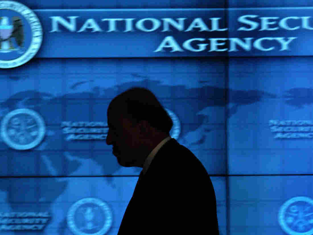Then-Director of National Intelligence John Negroponte walks the hallways of the Threat Operations Center inside the National Security Agency in 2006.