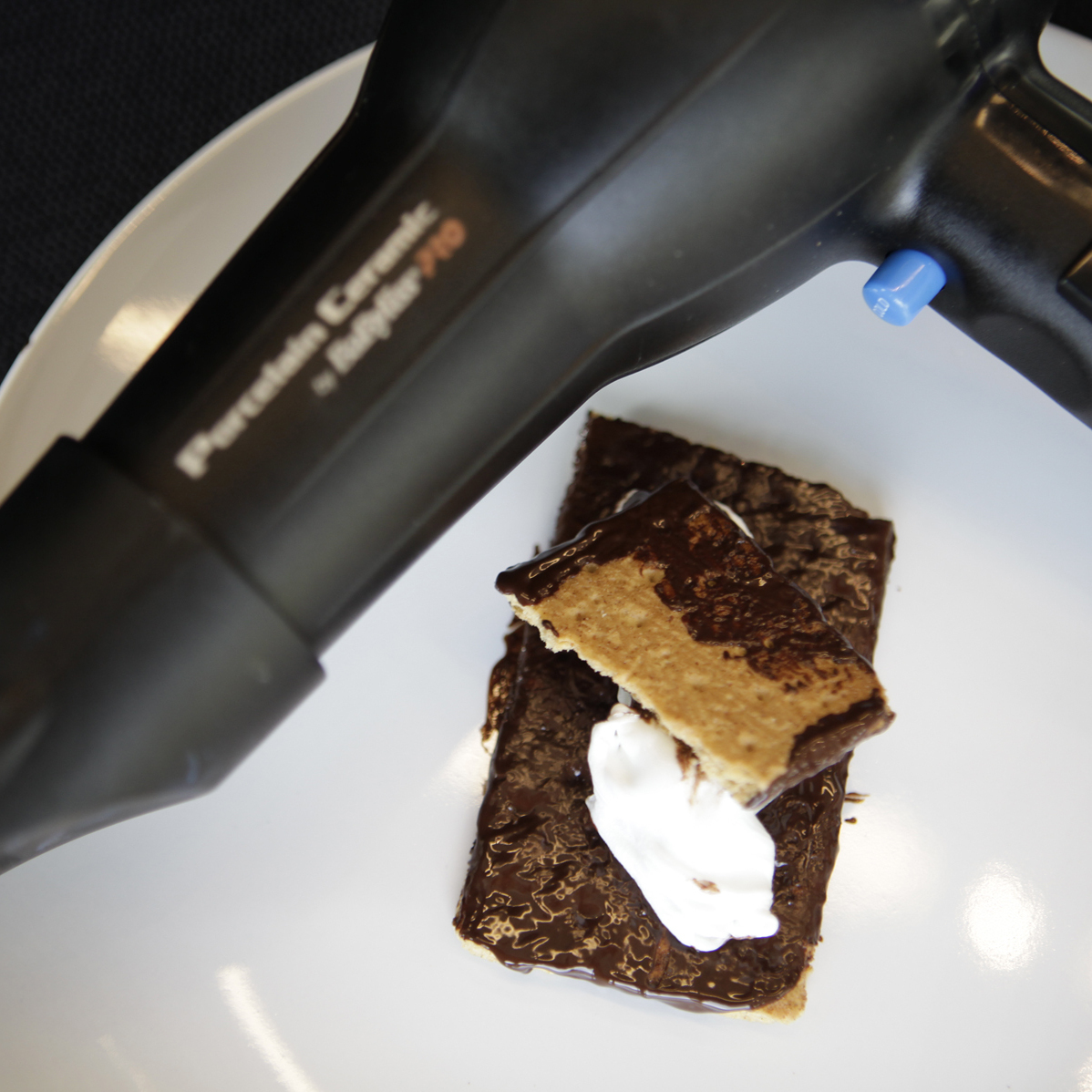 Not just for straightening curls, the hair dryer can also make a killer s'more.