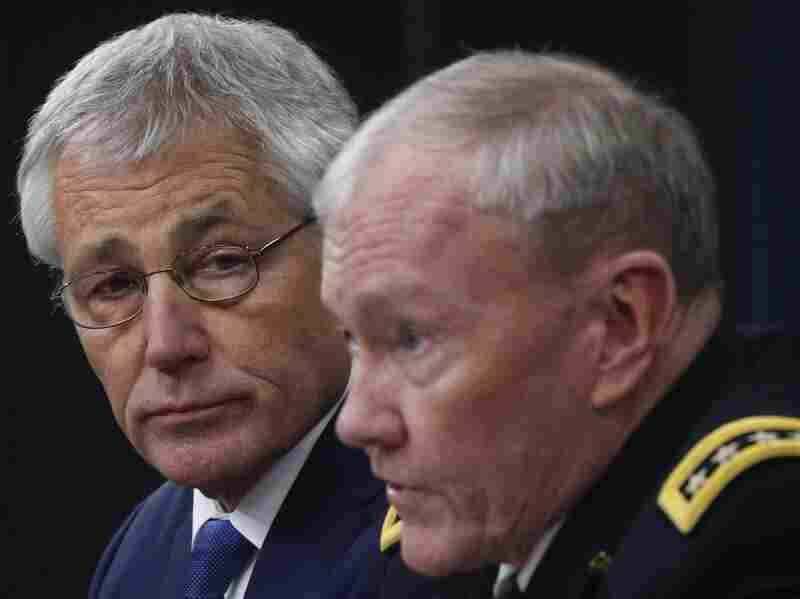 Defense Secretary Chuck Hagel and Chairman of the Joint Chiefs of Staff Gen. Martin Dempsey brief reporters at the Pentagon in Washington, on Thursday.