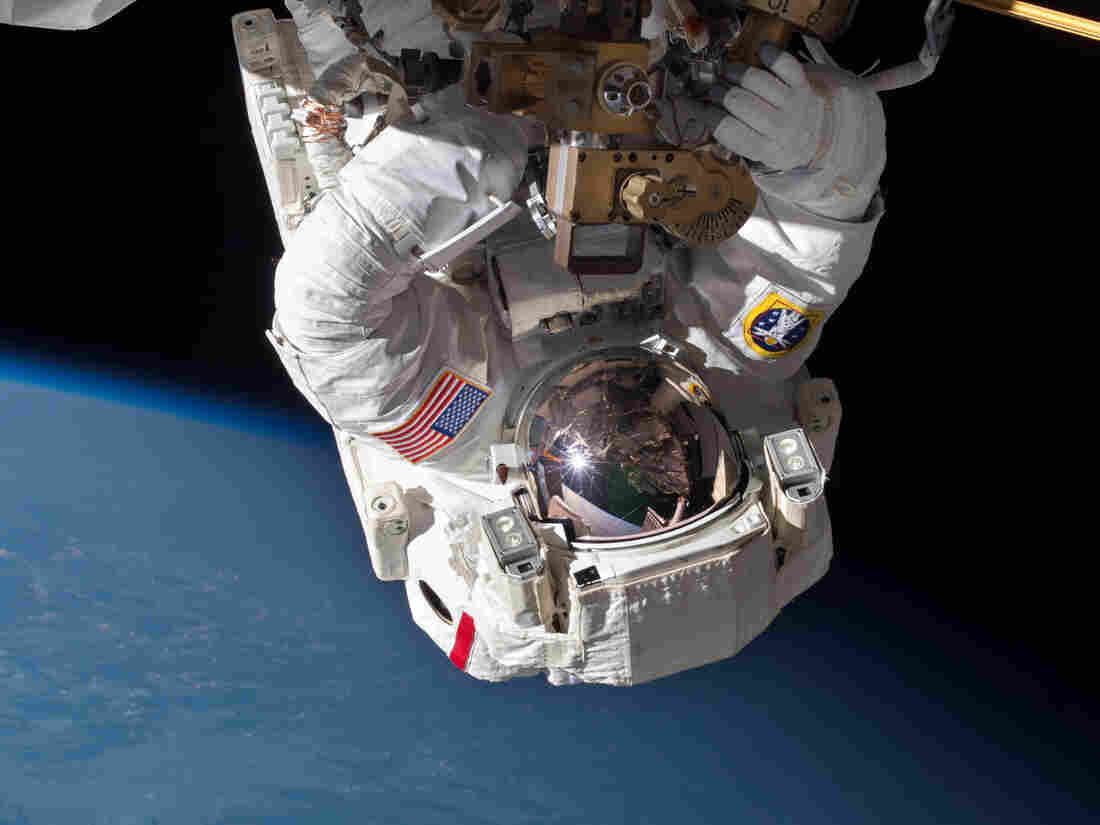 NASA astronaut Chris Cassidy performs a spacewalk in May to inspect and replace a pump controller box on the International Space Station. On Saturday, two astronauts will perform the first in a series of similar spacewalks to fix a broken cooling line on the ISS.