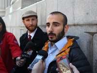 Derek Kitchen (left) and his partner, Moudi Sbeity, talk with the media outside Frank E. Moss United States Courthouse earlier this month, where a challenge to Utah's same-sex marriage ban by three gay couples was decided on Friday.