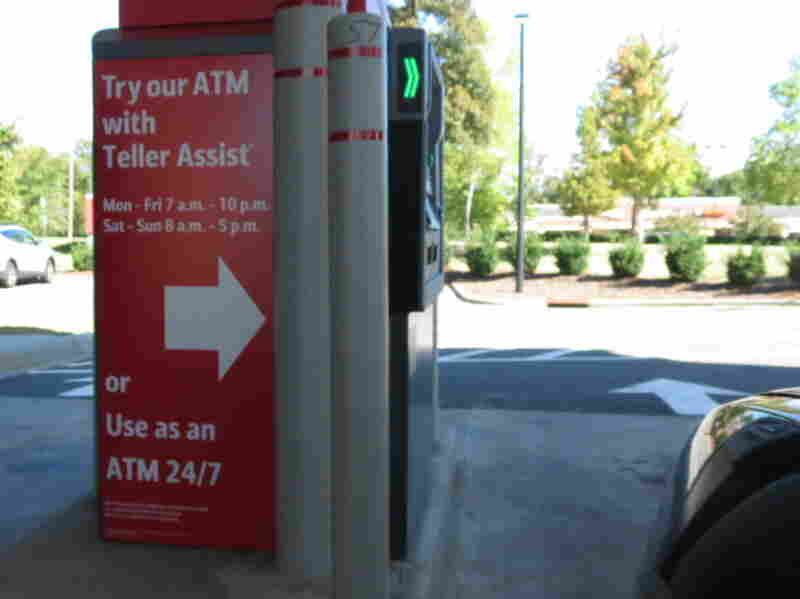 """An ATM in Charlotte, N.C., features """"teller assist,"""" which allows users to video chat with a remote bank representative."""