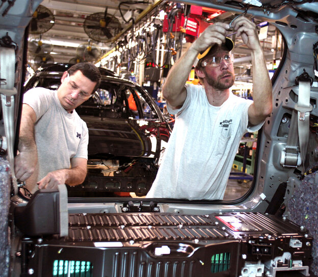 At a Ford plant in Michigan, workers load