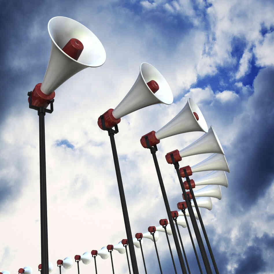 An array of loudspeakers against a dramatic sky. 3D render with HDRI lighting and raytraced textures.