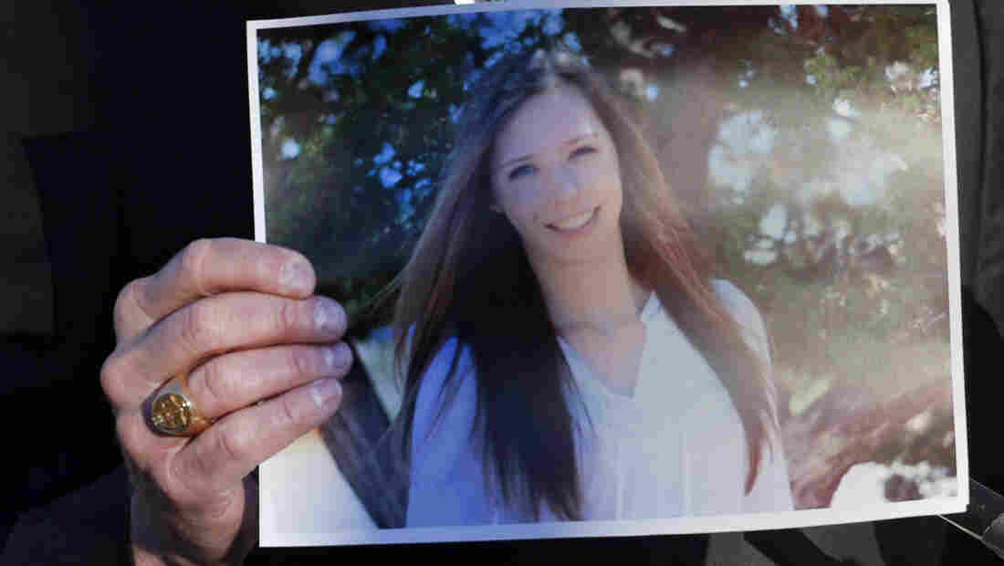 Arapahoe County Sheriff Grayson Robinson holds a picture of Claire Davis, 17, at a briefing at Arapahoe High School in Centennial, Colo., the day after the Dec. 13 shooting. Davis died Saturday.