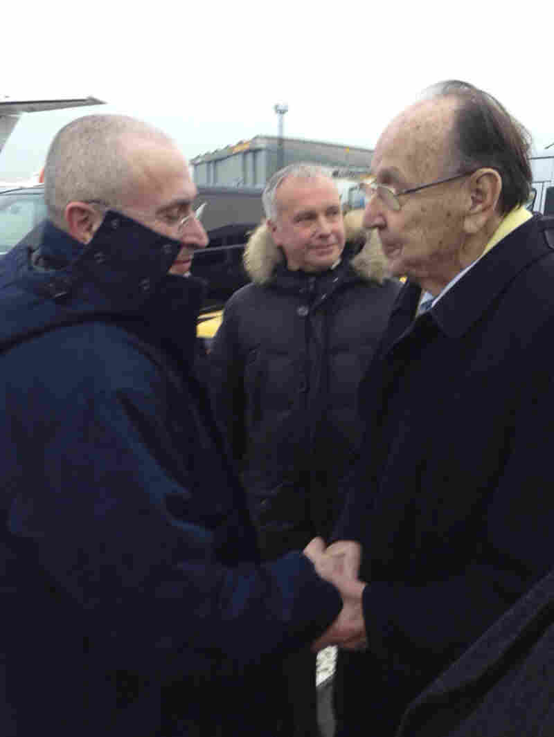 Mikhail Khodorkovsky, left, shakes hands with former German Foreign Minister Hans-Dietrich Genscher at the airport in Berlin on Friday.