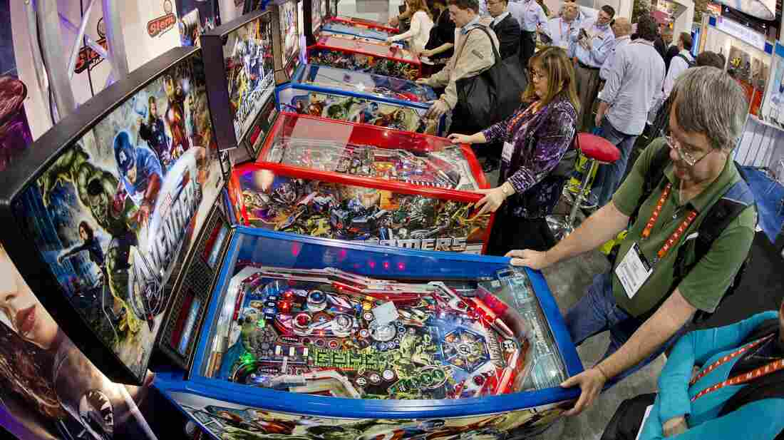 Pinball convention-goers play on a bank of Stern machines at the Consumer Electronics Show in Las Vegas in January. The company is no longer the only pinball manufacturer.