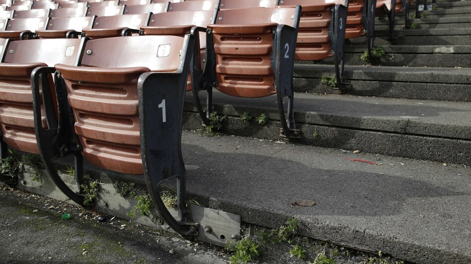 Plants grow through cracks in the lower seating at Candlestick Park in San Francisco.