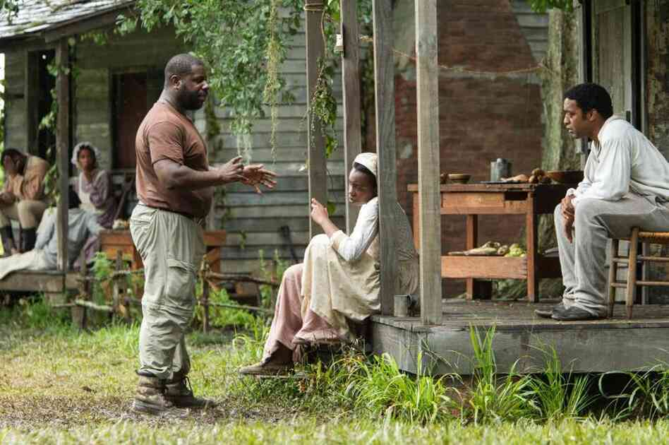 Director Steve McQueen works with his cast on the 12 Years a Slave set.