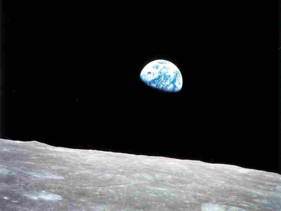 """The iconic """"Earthrise"""" photo taken by astronaut Bill Anders through a window on the Apollo 8 command module on Dec. 24, 1968."""