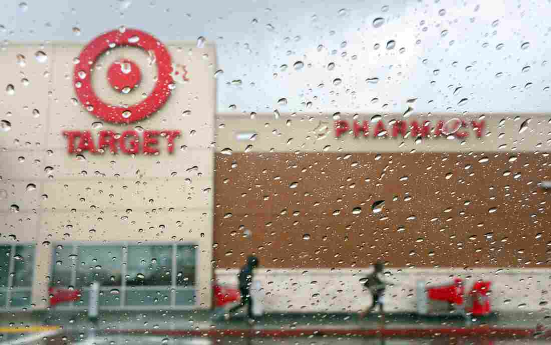 A couple of shoppers leave a Target store on a rainy afternoon in Alhambra, California.
