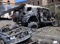 A photo provided by Yemen's Defense Ministry shows damaged vehicles after an al-Qaida affiliate attacked the ministry's complex in Sanaa on Dec. 5.