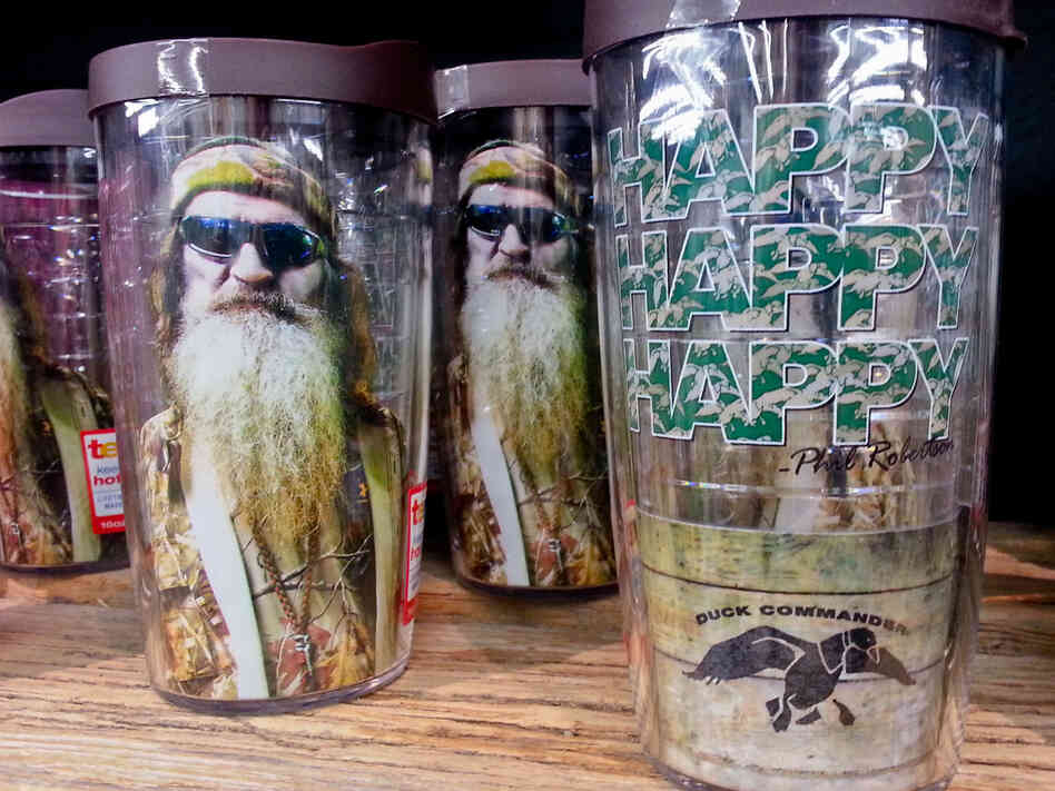 Duck Dynasty plastic drinking glasses with Phil Robertson's image are among the merchandise on sale at the Duck Commander store in West Monroe, La., and at other busines