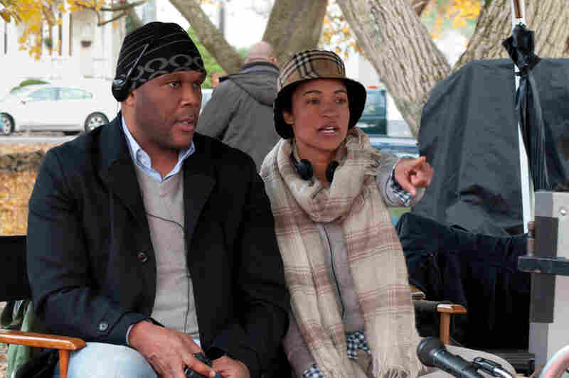 Writer-director Tina Gordon Chism sits on the set of Peeples with producer Tyler Perry, who also wrote and directed Temptation and A Madea Christmas this year.