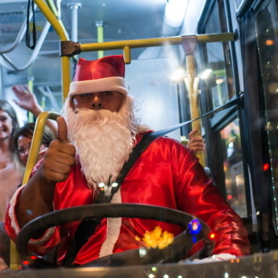 A driver disguised as Santa Claus drives a public bus at Paulista Avenue in Sao Paulo, Brazil.