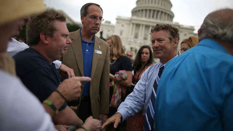 Sen. Rand Paul (R-Ky.) greets supporters during a tea party rall