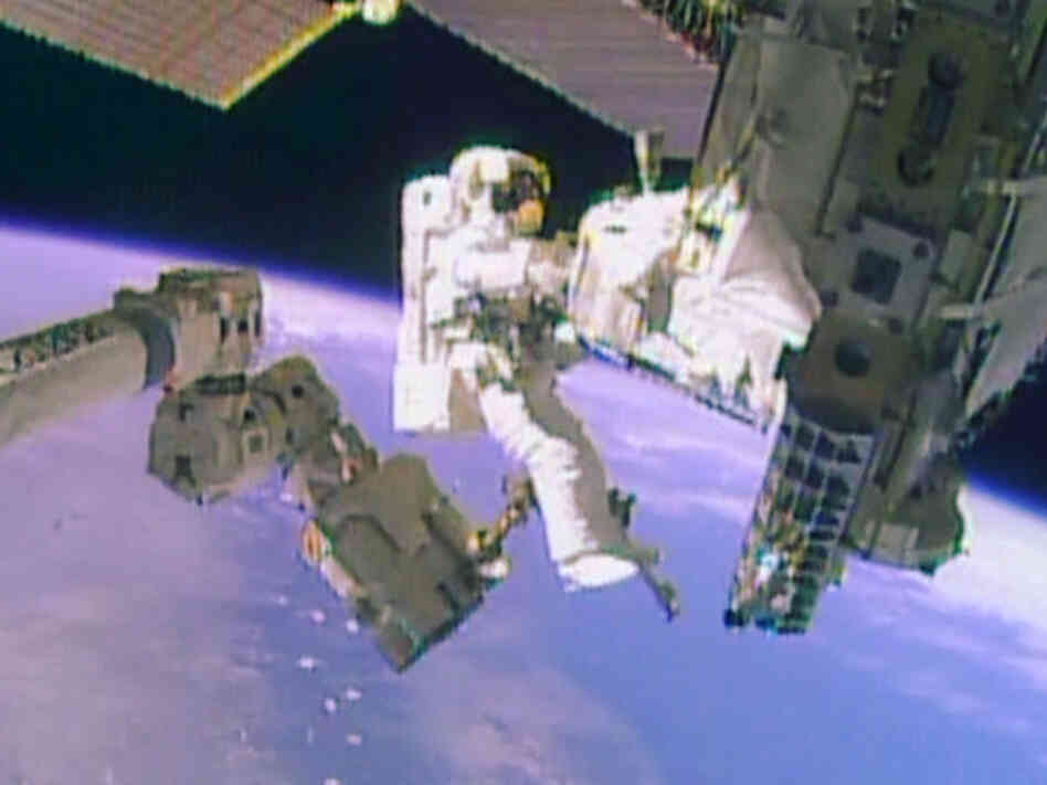 A NASA television image from Tuesday's spacewalk to replace a coolant pump on the Internat