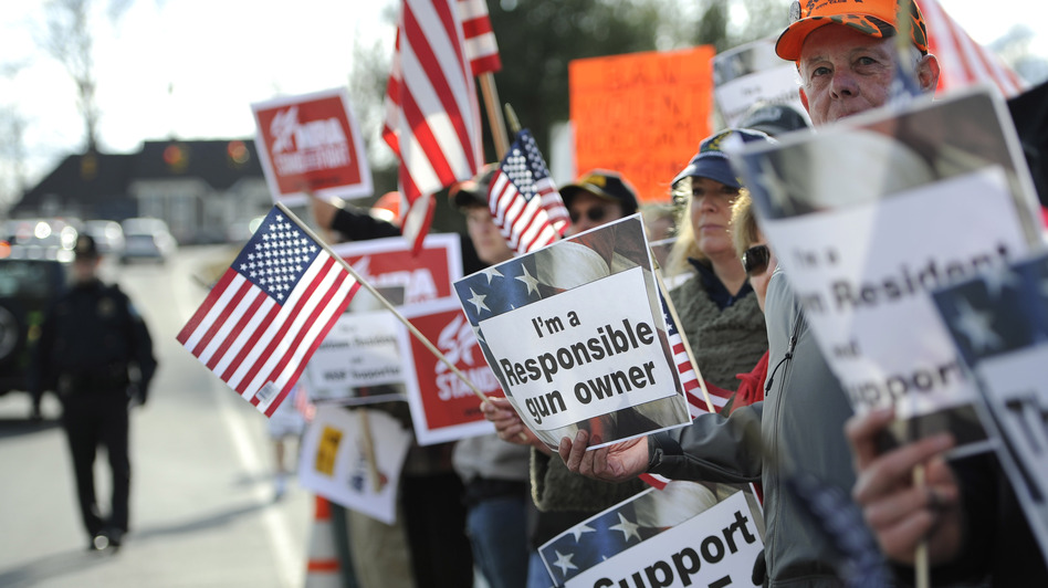 Supporters for gun rights gather outside the National Shooting Sports Foundation headquarters in Newtown, Conn., on March 28. (Jessica Hill/AP)